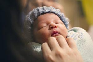 Cute newborn baby with hat
