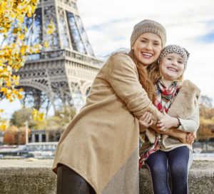 French family near Eiffel tower in Paris, France