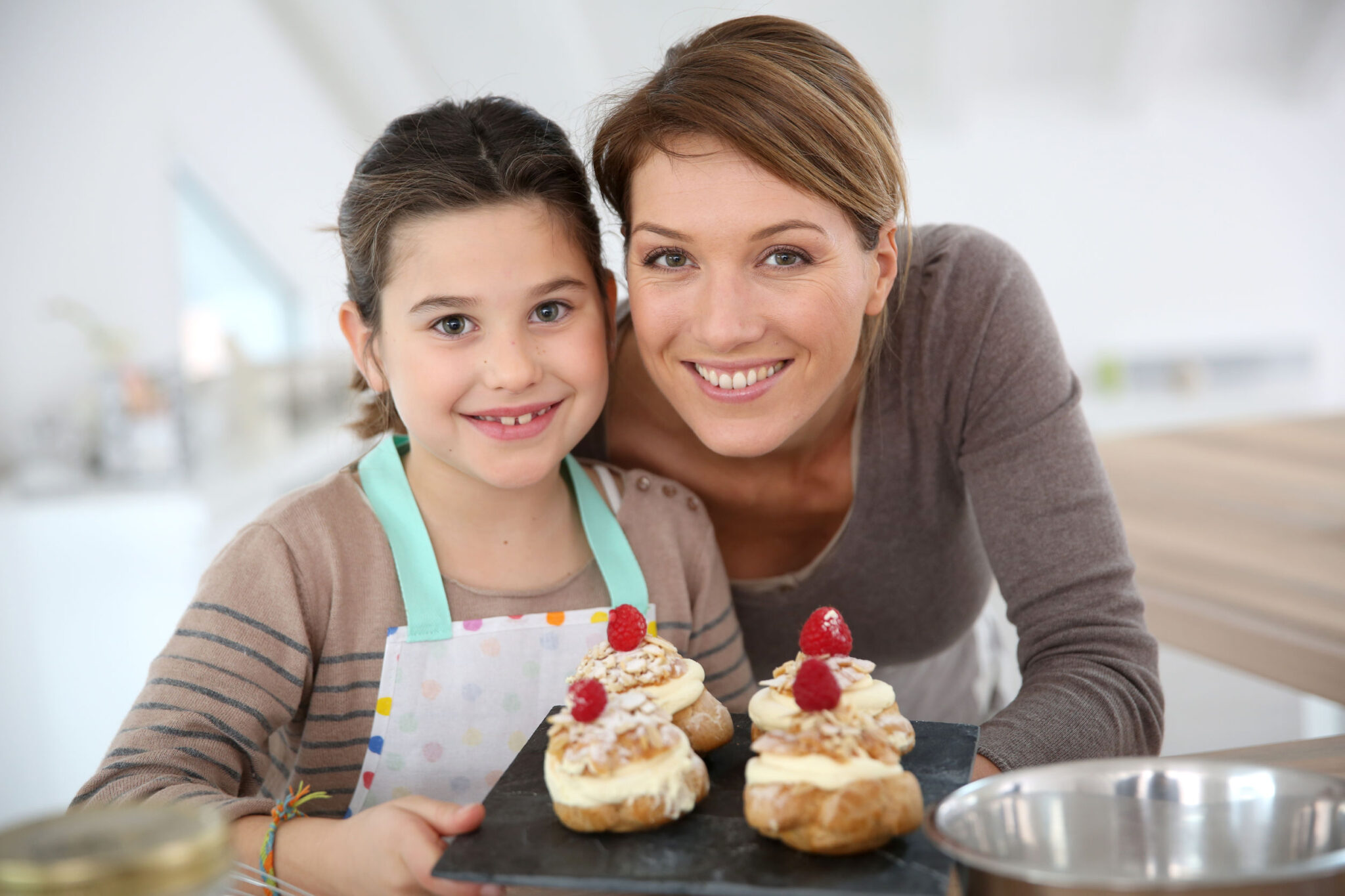 Nanny and girl, brunettes, baking decorative cakes
