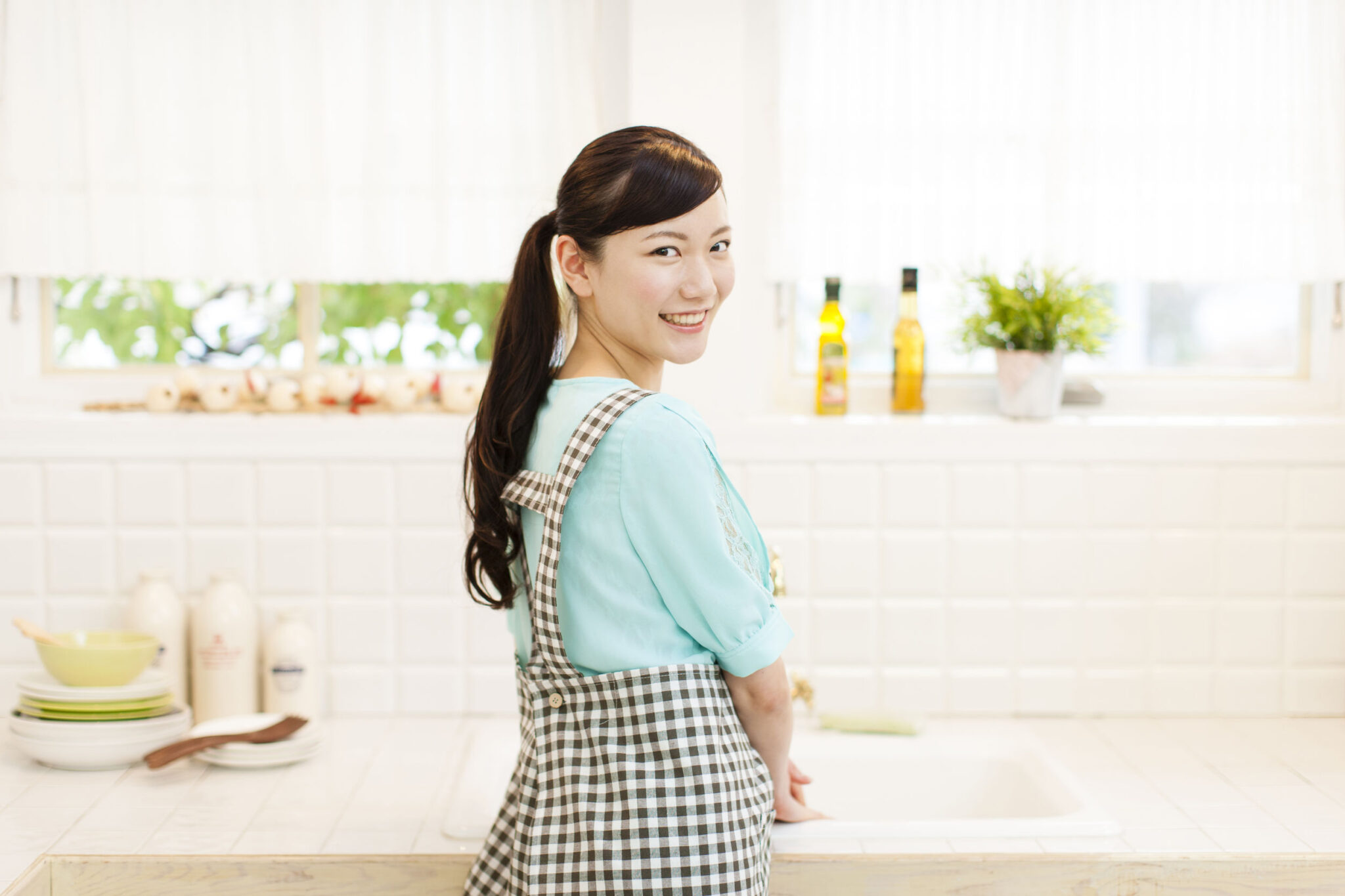 Nanny Housekeeper at the sink