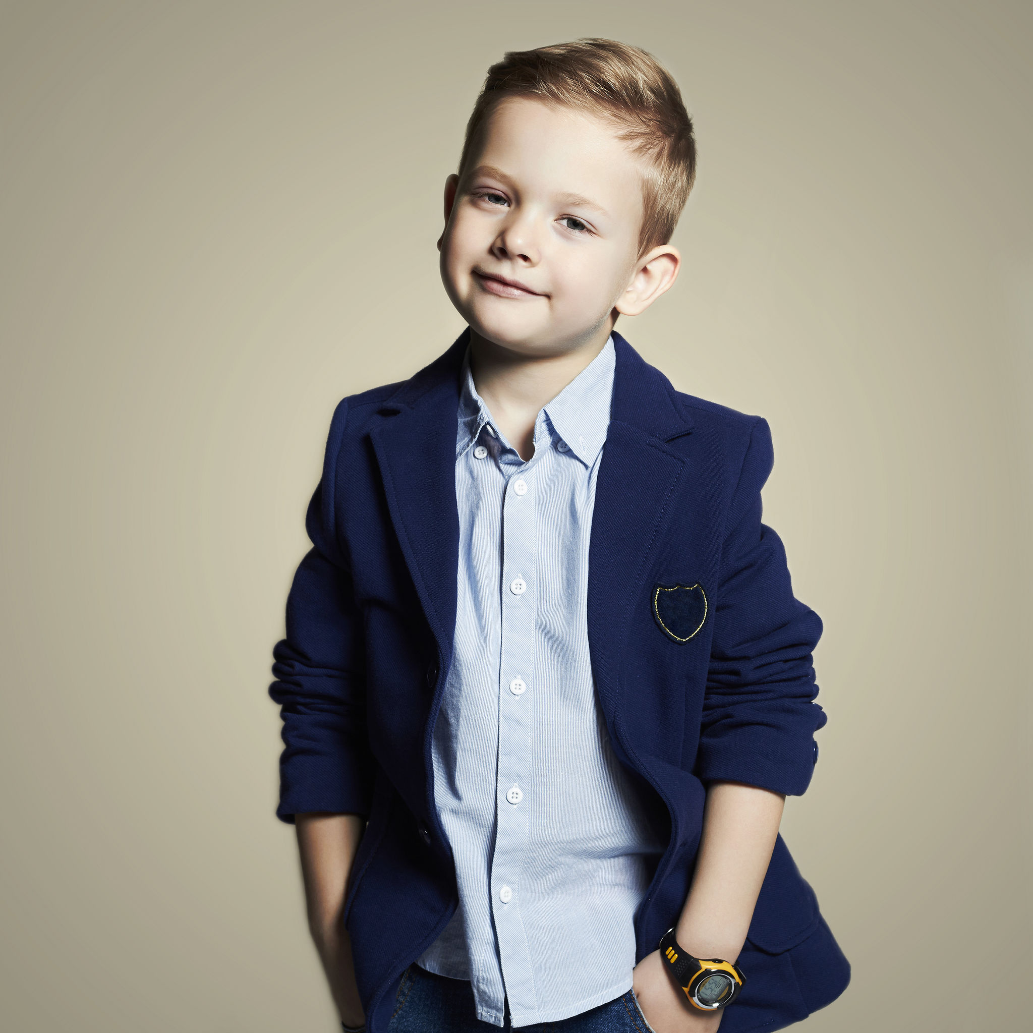 Smart young boy in blazer