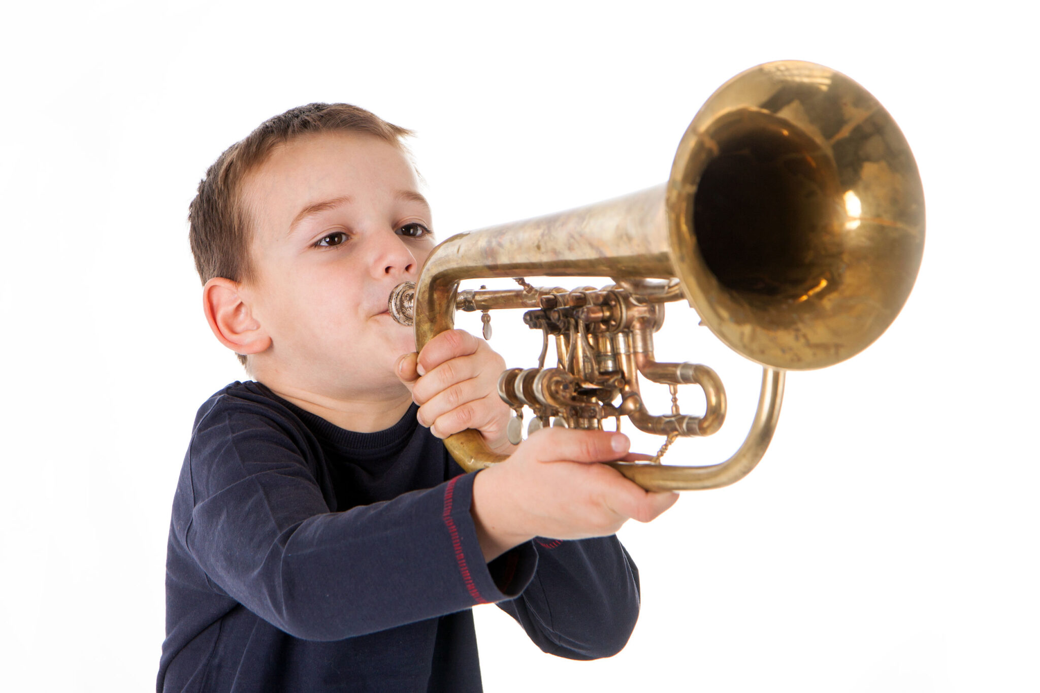 Boy blowing his own trumpet